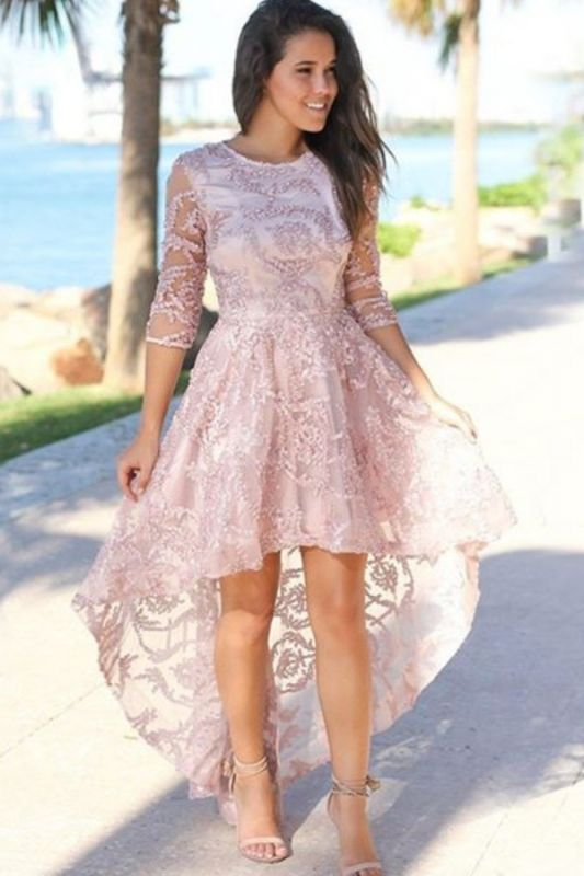 Robe de bal chic et haute bijou avec manches 3/4 | Superbe robe de bal rose en dentelle avec perles