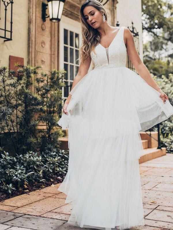 Vestido de novia 2021 Una línea Cuello en V Sin mangas Vestido de pastel de tul multicapa Vestido de novia