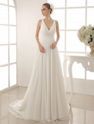 Vestido de novia con cuello de pico y pedrería con vaina_1