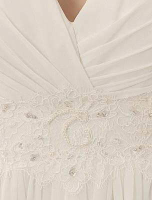 Vestido de novia con cuello de pico y pedrería con vaina_8